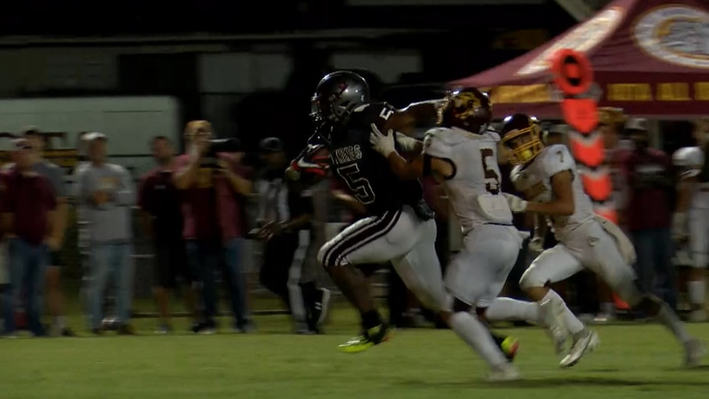 Trevor Etienne delivers a stiff arm on one of his six touchdown runs against Iota