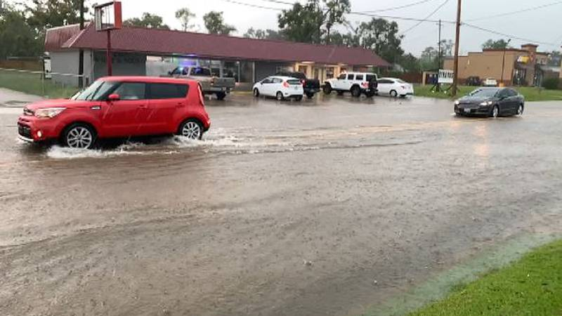 Those driving carefully with high riding vehicles could make it through flooded streets.