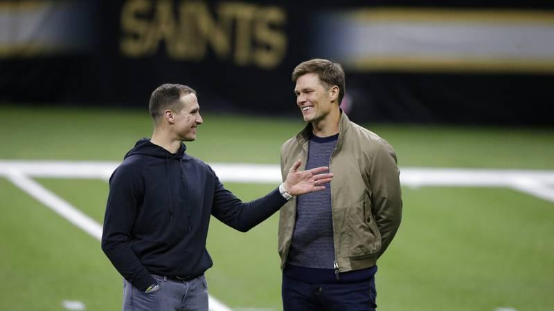 New Orleans Saints quarterback Drew Brees left, speaks with Tampa Bay Buccaneers quarterback...