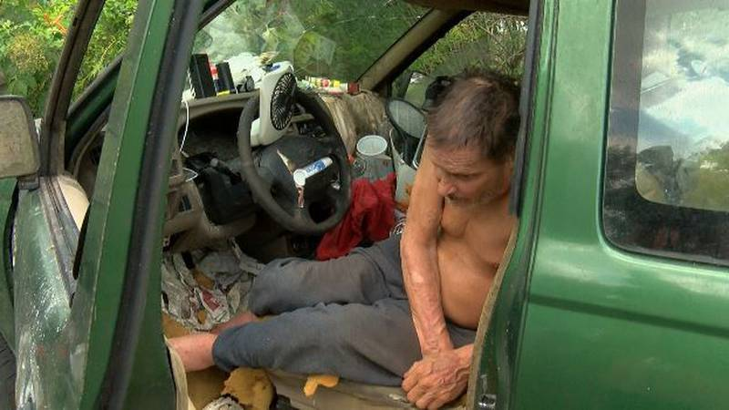 On this hot July day, Landry is where he usually is - in his truck asleep in the driveway of...
